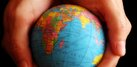 image of two hands holding a globe