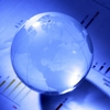 Clear Globe Paperweight sitting on business papers