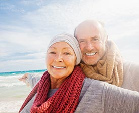An elderly man and woman smiling together, representing disposable hygiene products and nonwoven adhesives in the adult care market.