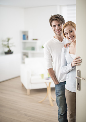 Couple Standing Together in their Home
