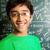 image of a boy in front of a chalk board.