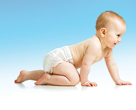Baby in diaper crawling