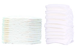 A stack of thinner core disposable hygiene products made with non woven adhesive technologies